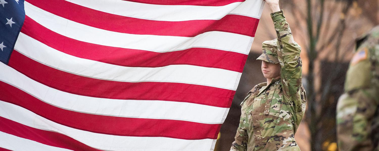 Photo of Kent State University ROTC cadet with American flag