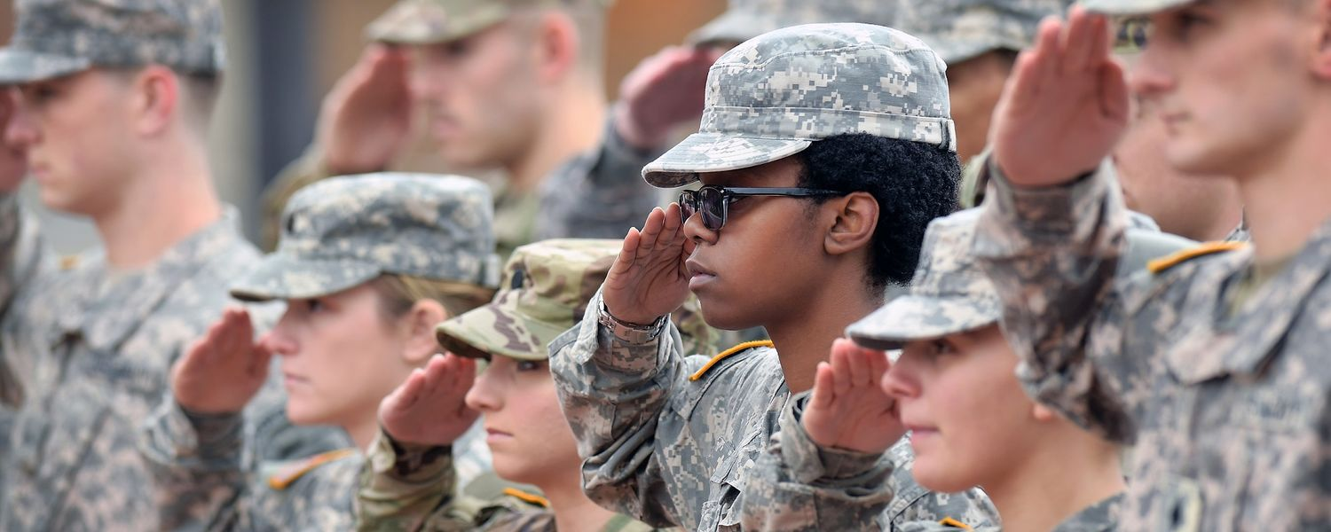 Kent State University ROTC cadets salute and stand at attention as the U.S. flag is being raised during the university's annual Veterans Day observance.