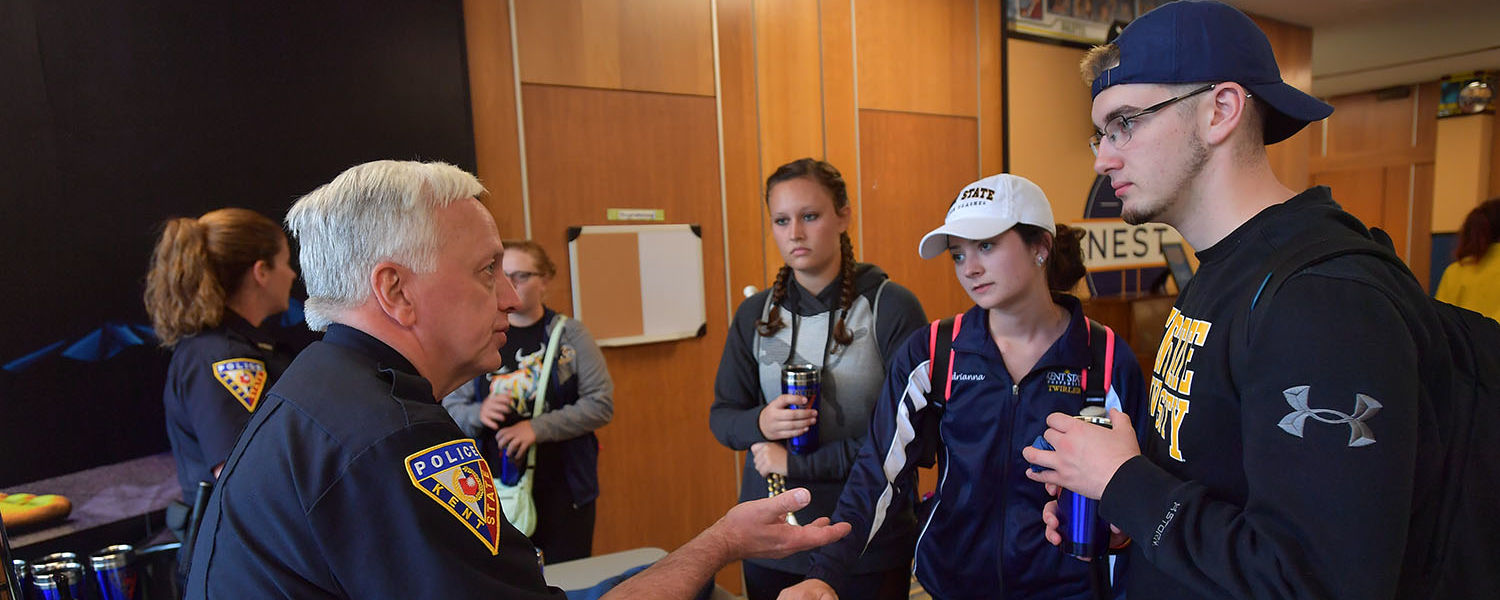 Kent State Assistant Chief of Police Bill Buckbee talks with students at the first-ever Coffee With a Cop event in the Nest.