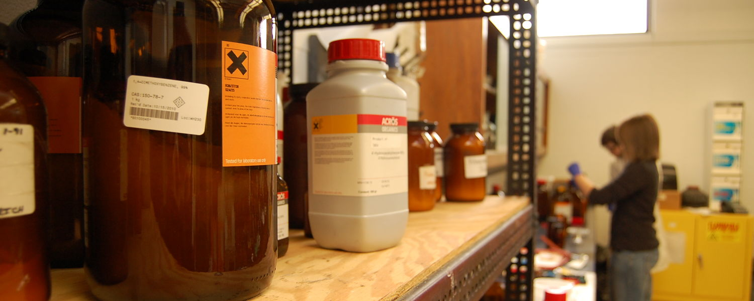 Chemistry stockroom employees prepare chemicals for a laboratory.