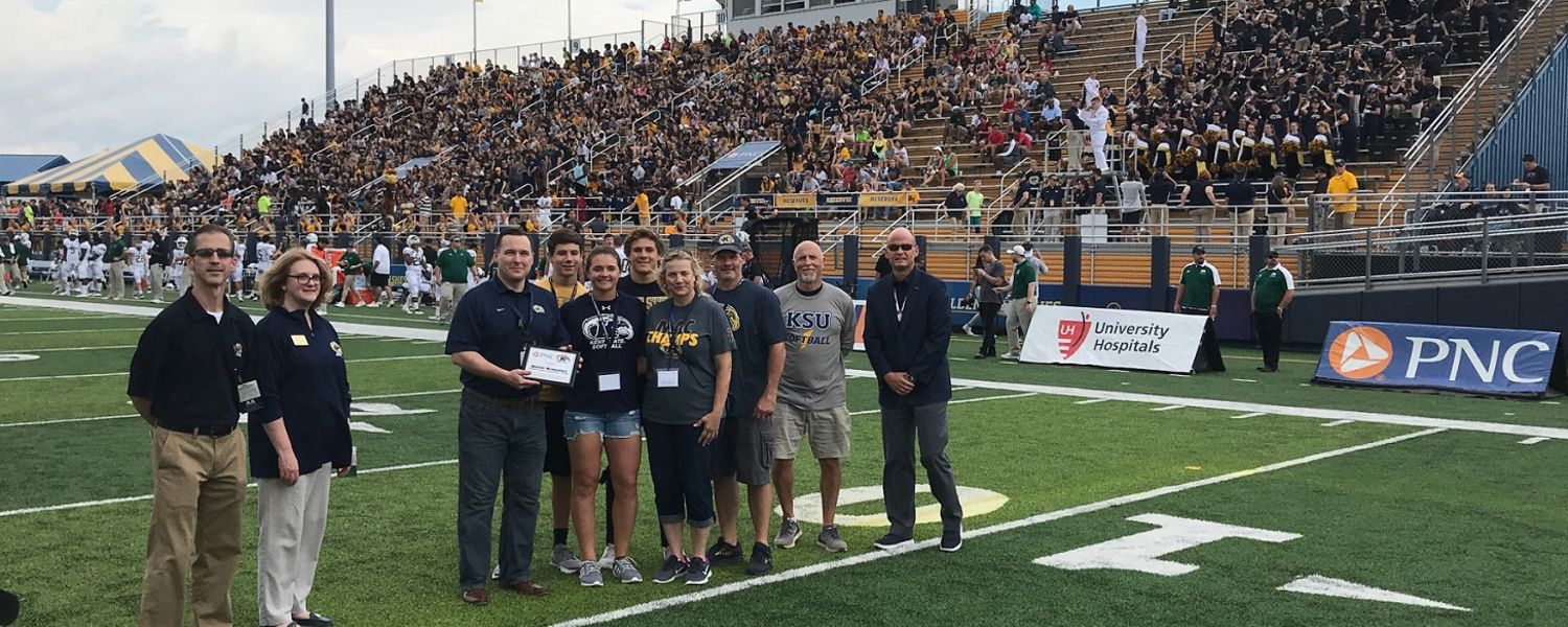 PNC Bank recognizes Kent State student Hunter Brancifort (fifth from left), who is joined by her family along with representatives from Kent State's administration, Department of Intercollegiate Athletics and the College of Business Administration.