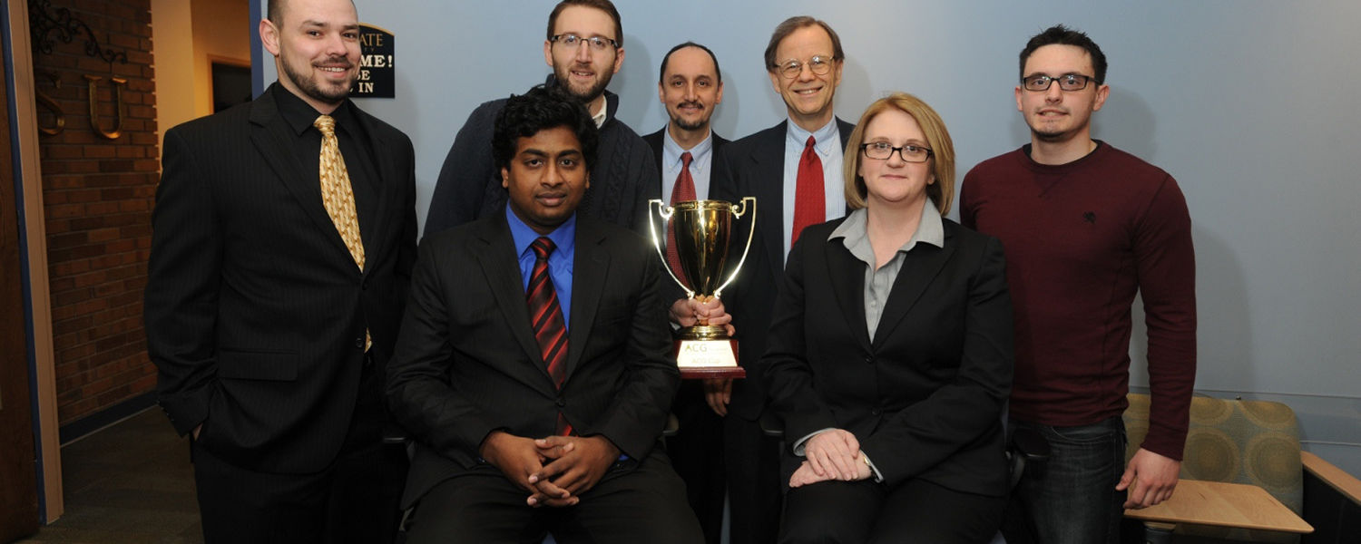 Deborah Spake, dean of Kent State University's College of Business Administration, was presented with  the trophy won by Kent State's MBA team in the Cleveland Association for Corporate Growth Competition.