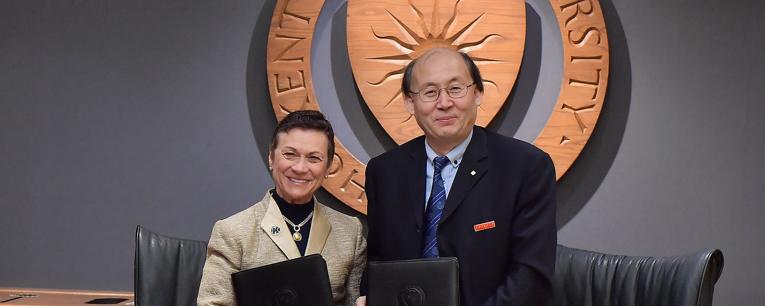 Kent State University President Beverly Warren stands with Xi'An International Studies University President Wang Junzhe after signing a partnership agreement between the two universities.