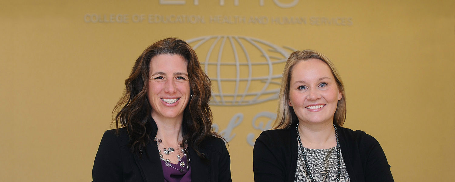 """""""Kristie Pretti-Frontczak (left) and Sanna Harjusola-Webb, faculty members in Kent State University's College of Education seek applicants for the Early Intervention in Natural Environments Specialization Training through Distance Learning Program."""