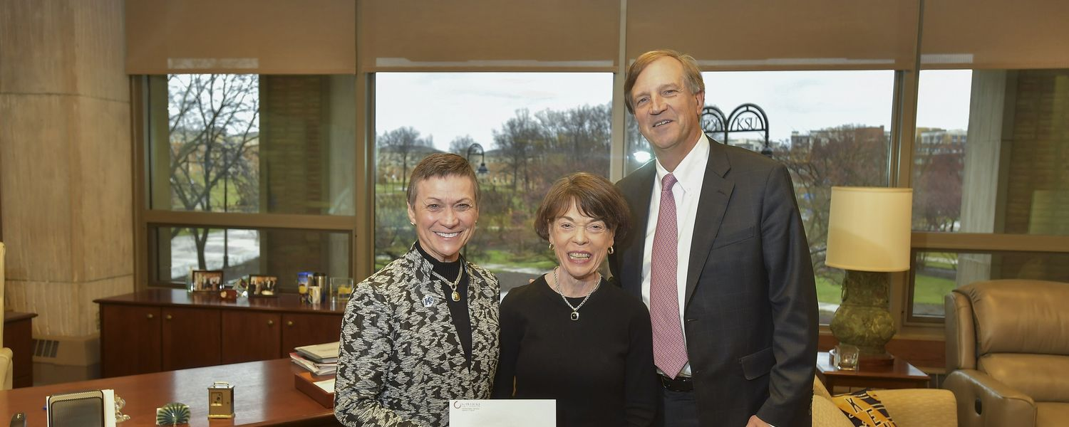 Kent State University President Beverly Warren (left) receives a $1 million grant for the university's Institute for Applied Linguistics from Mary and Ted Gawlicki of the Gawlicki Family Foundation.