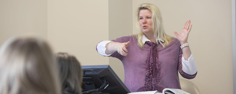 Kent State Ashtabula Chemistry Professor Ann Abraham instructs during class