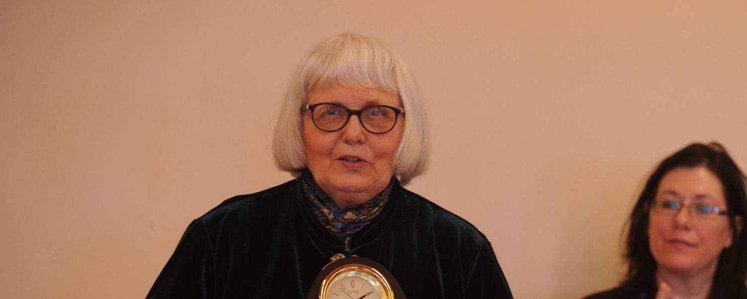 Dolores Noll, Ph.D., Kent State University Professor Emeritus of English and pioneer for LGBTQ rights and people, accepts the university's inaugural Diversity Trailblazer Award in 2010.