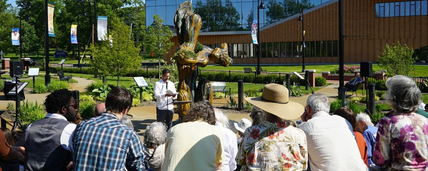 David Hassler, director of the Wick Poetry Center at Kent State University, reads a poem during the River of Words poetry reading in the center's Poetry Park.