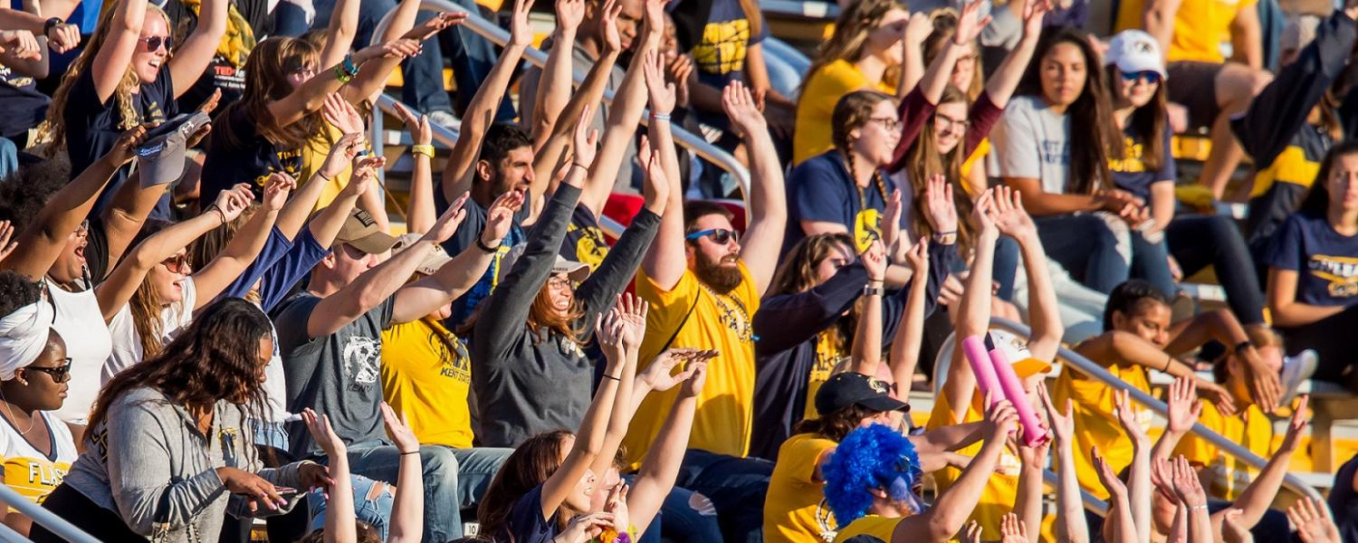 Fans of the Kent State Golden Flashes cheer at Dix Stadium.