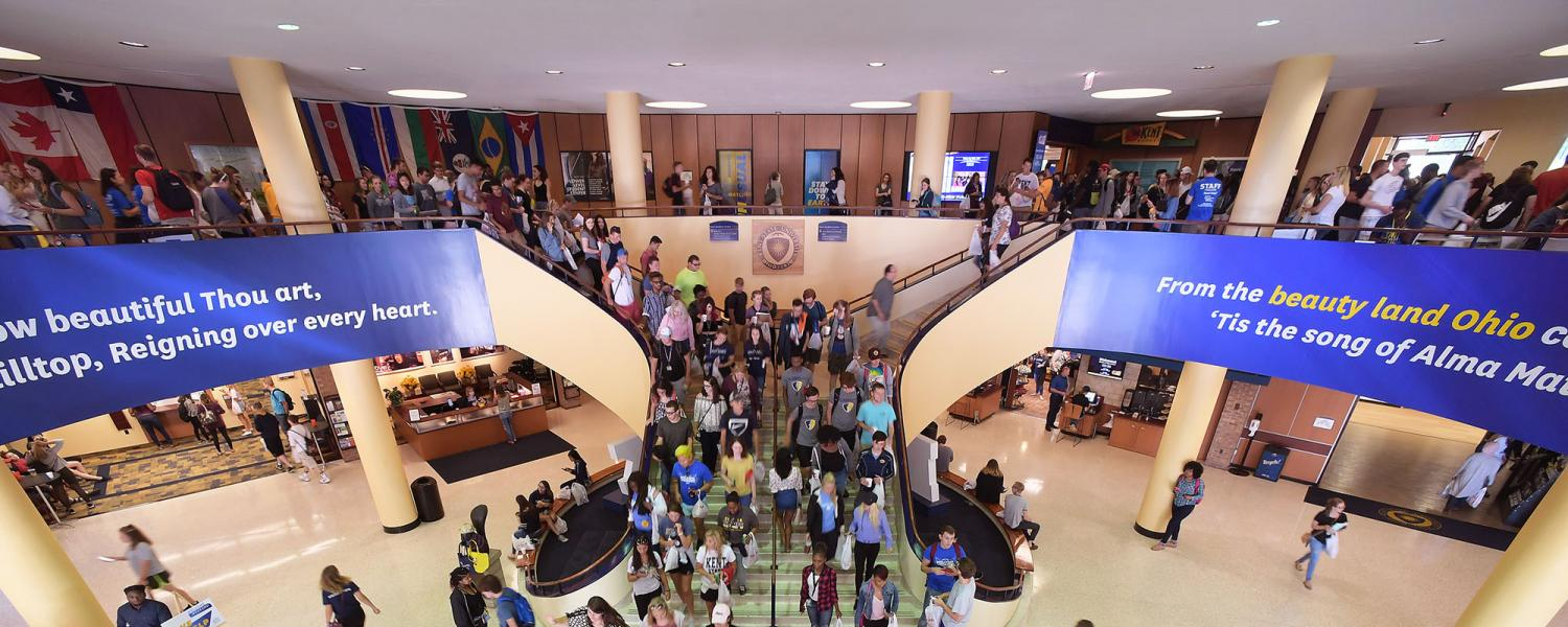 Kent state university students fill the steps of the kent student center during peak hours at