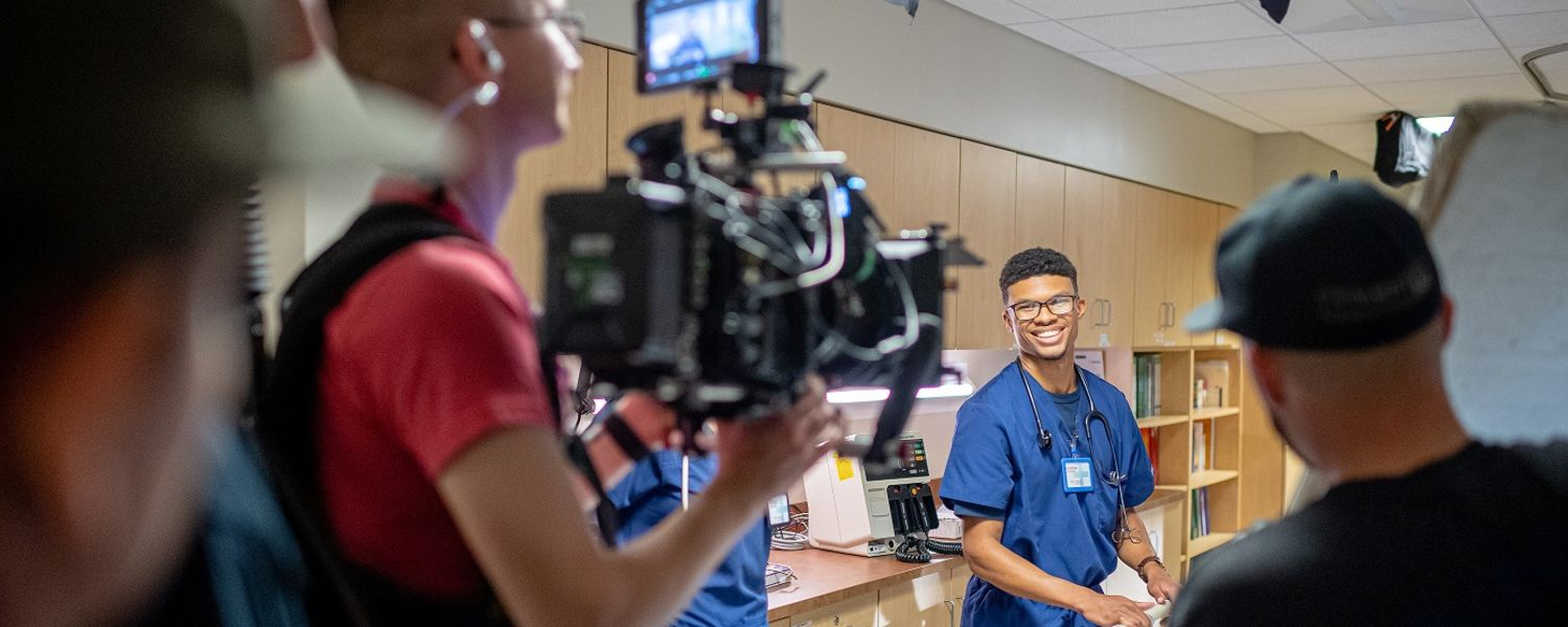 A video crew gets footage of a Kent State University nursing student for the new Kent State TV commercial.