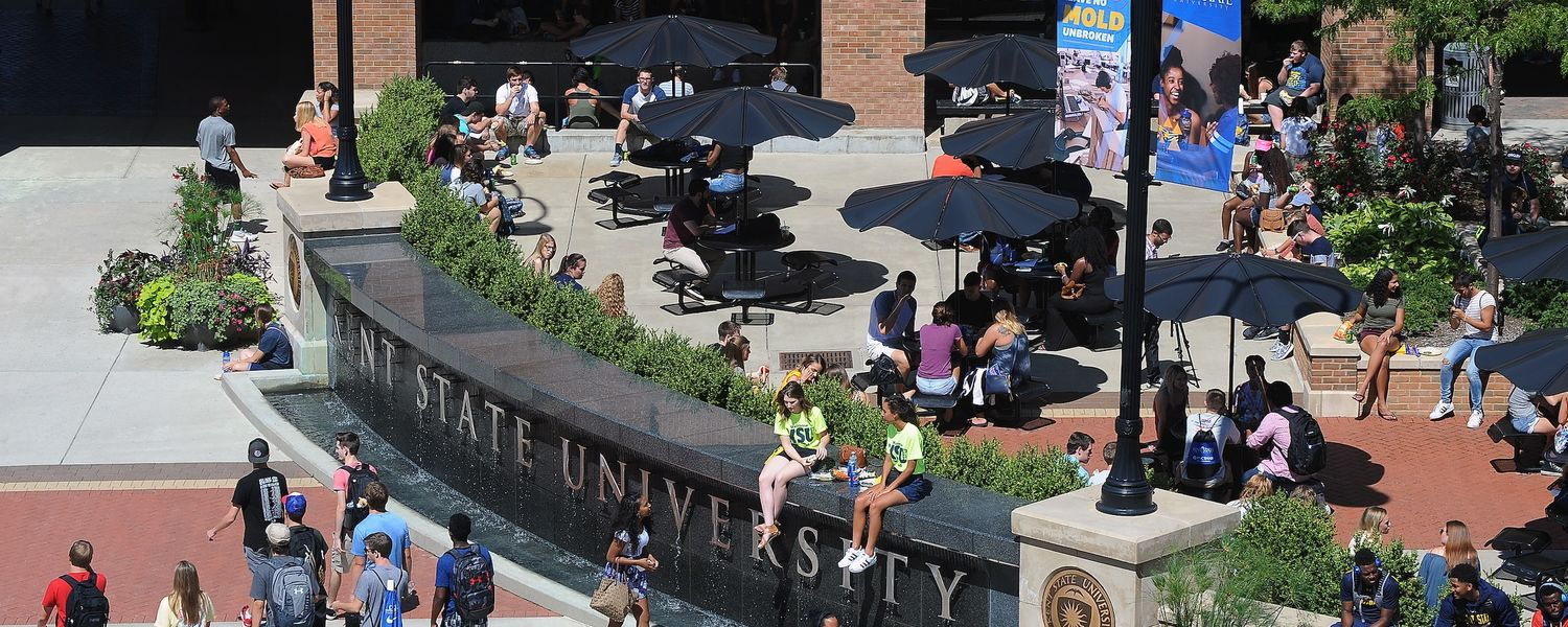 Kent State University students walk to and from class while others hang out on Risman Plaza.
