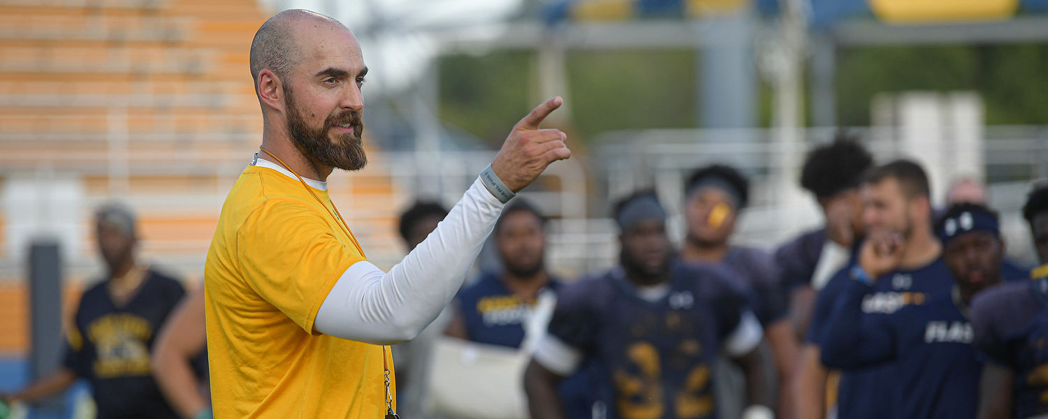 Kent State head football coach Sean Lewis leads a practice at Dix Stadium.