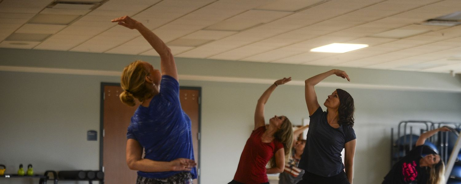 Kent State University employees participate in the Lunchtime Yoga session, a regular wellness offering on Tuesdays and Thursdays.