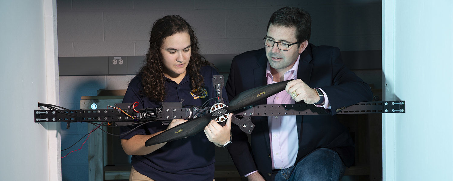 Blake Stringer, Ph.D. (right), associate professor of aerospace engineering at Kent State, and research assistant Kendy Edmonds study the power needs for a new larger generation of drones for a research grant funded by the Army Research Laboratory.