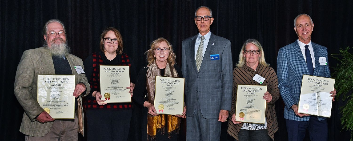 Members of the Kent State University community receive a 2018 Public Education and Awareness Award during the Ohio History Connection's State Historic Preservation Office Awards. Pictured (left to right) are Bradley Keefer, Mindy Farmer, Laura Davis, Burt