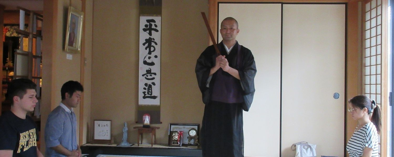 Kent State University graduate student Cody Ruiz (far left) practices zazen (seated meditation) at a Buddhist temple.