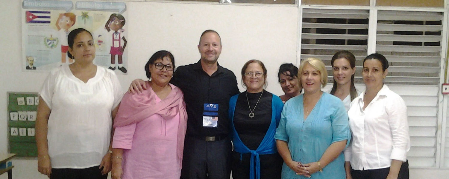 Kevin J. Spence (third from left), a Kent State University higher education administration doctoral student, is pictured with instructors of the University of Cienfuegos' Pedagogical Institute, which prepares graduates for careers in education.
