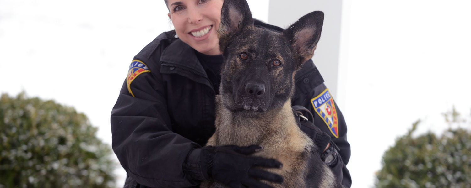 Kent State Police Officer Anne Spahr poses on Front Campus with Coco, Kent State's new police dog. Together, they form Kent State Police Services' first K-9 unit.