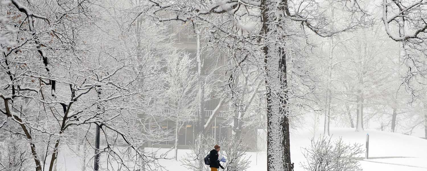 A Kent State student makes her way across the snowy Kent Campus following a fresh snowfall.