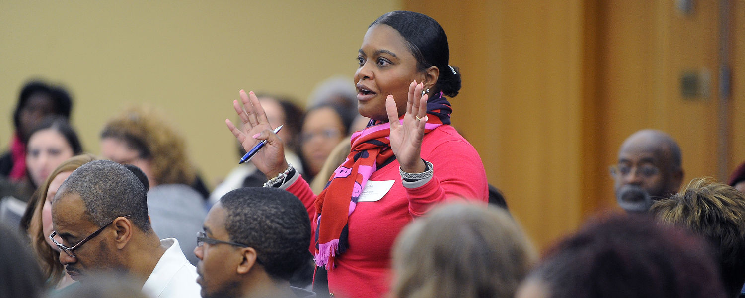 An audience member offers feedback during a panel discussion about why college is important and how society can make it an expectation for students now and in the future.