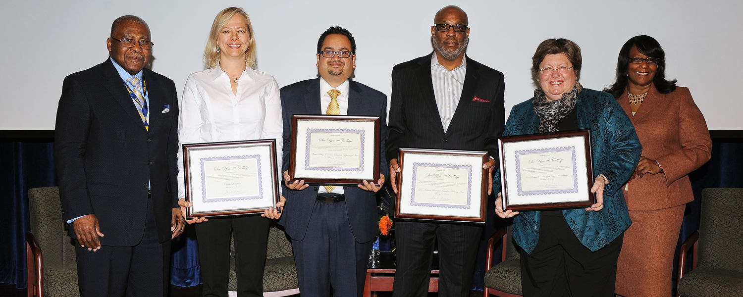 Panelists at the See You @ College conference are recognized for their contributions by Rev. Ronald J. Fowler (far left), special assistant to the president at Kent State, and Iris Harvey (far right), vice president for university relations at Kent State.