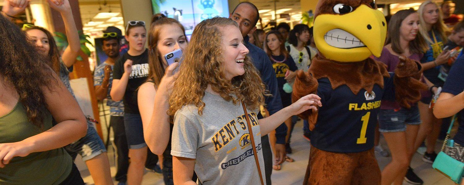 Kent State students dance with Flash, the university's mascot, during Late Night at the Library, a free event featuring food, games and music.