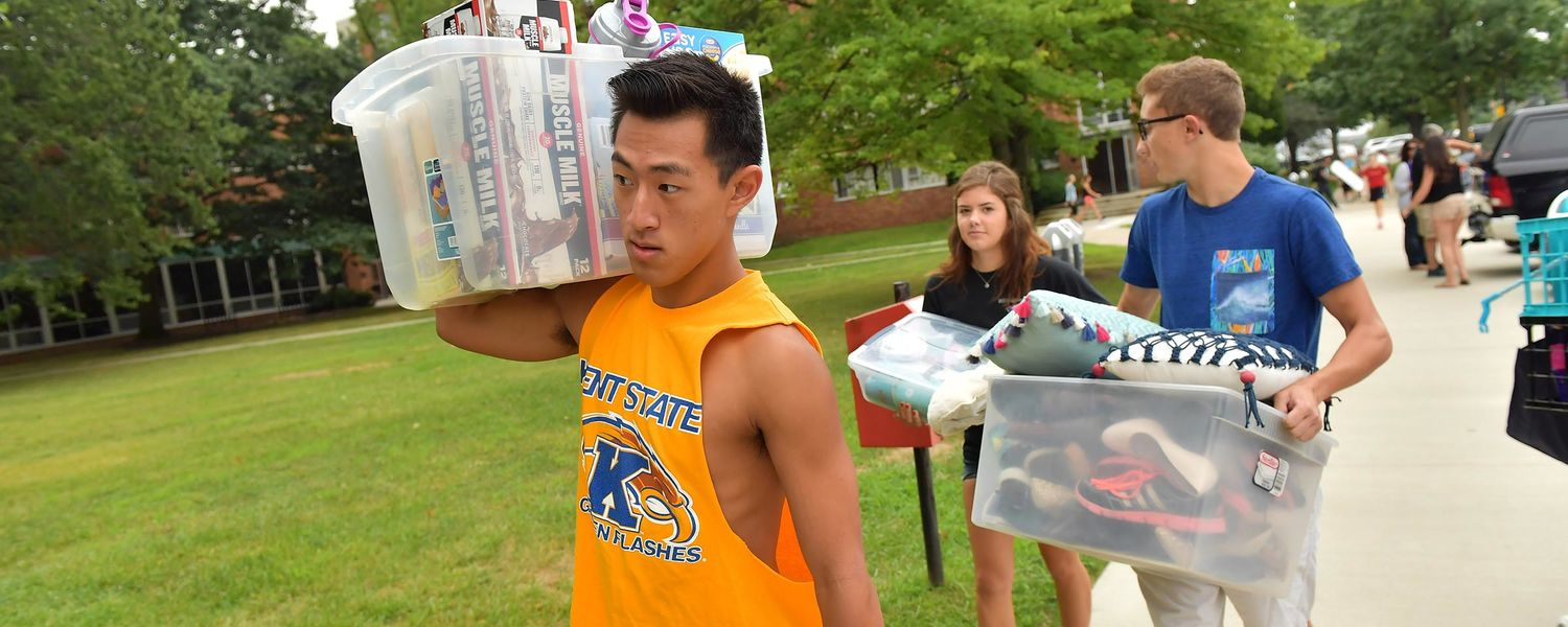 New Kent State students carry items to the residence halls.
