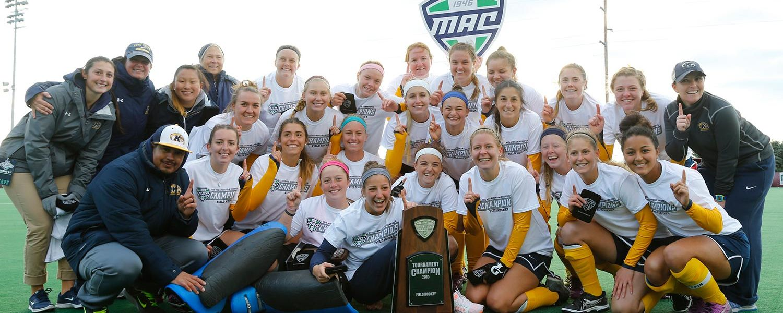 The Kent State field hockey team celebrates winning the 2015 MAC Tournament Championship.