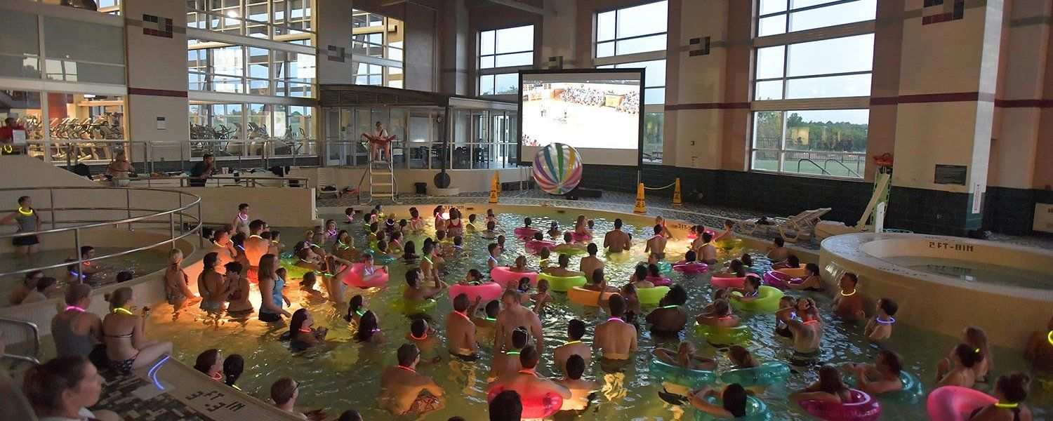 Kent State students float in the pool at the Student Recreation and Wellness Center during the Dive-In Movie.