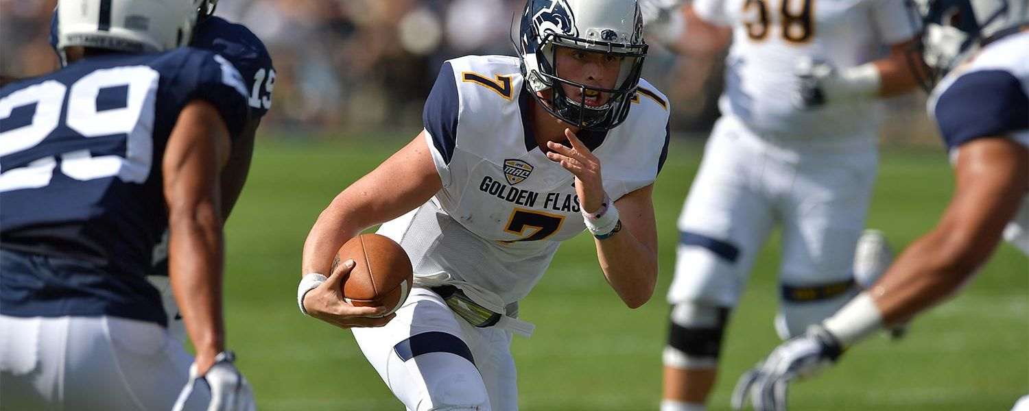 Kent State quarterback Justin Agner gains some yards against the Penn State Nittany Lions.