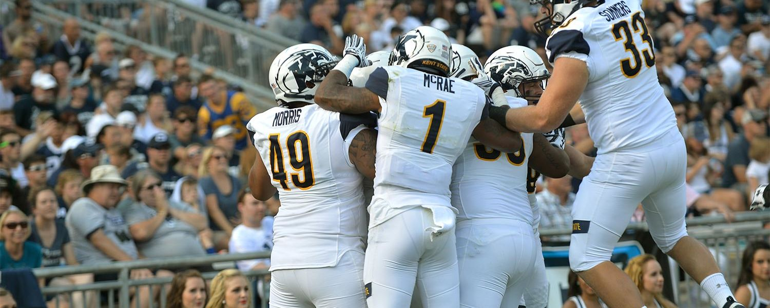 Members of the Kent State defense celebrate a touchdown after a recovered fumble during the 2016 season opener against Penn State.