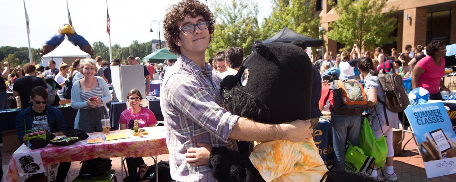 A Kent State student receives a hug from a black squirrel during the Black Squirrel Festival on Risman Plaza.
