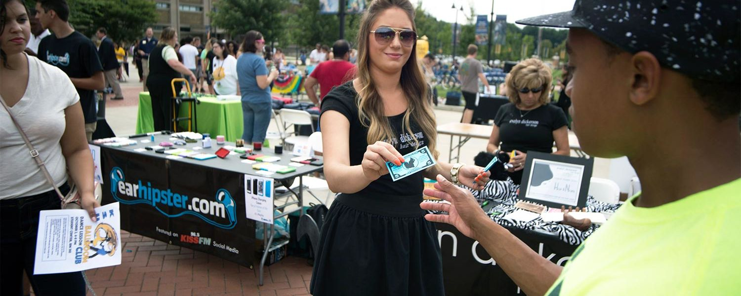 Local vendors hand out coupons, samples and other free stuff during Kent State's Black Squirrel Festival.