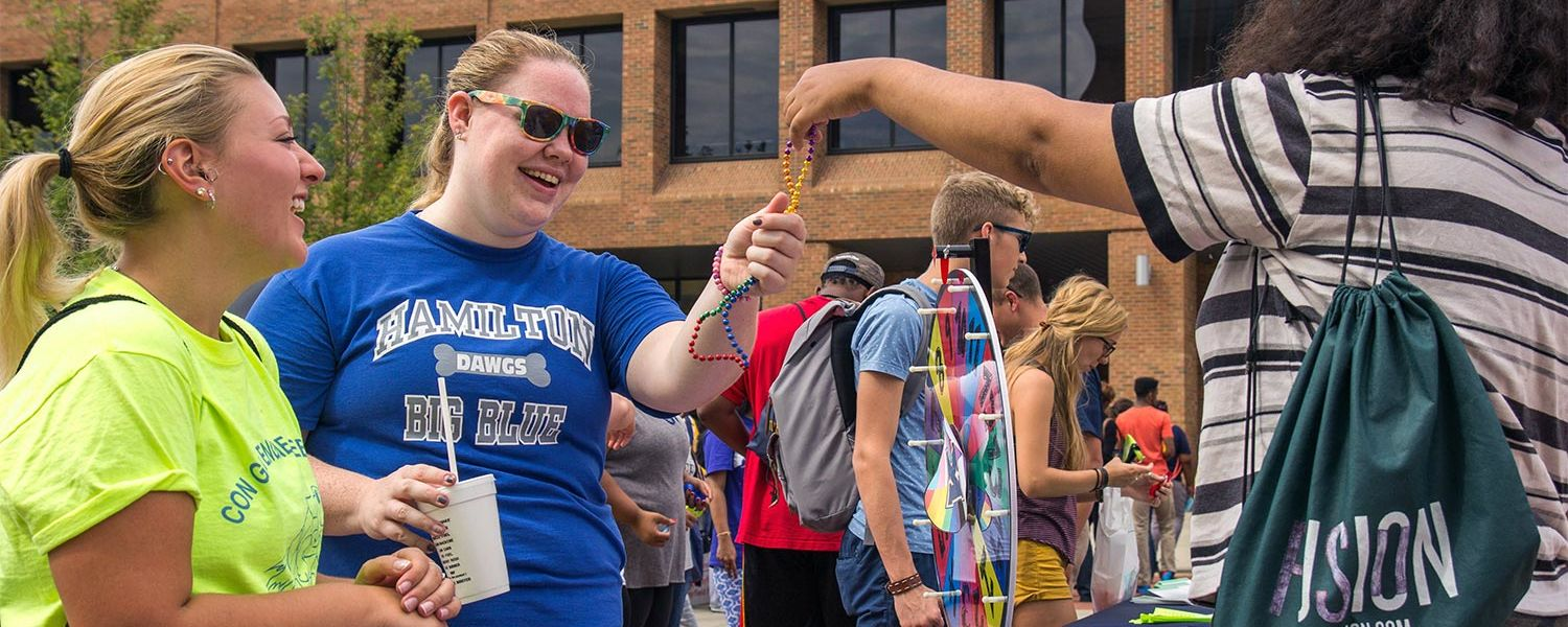 Kent State students collect free items during the university's annual Black Squirrel Festival.