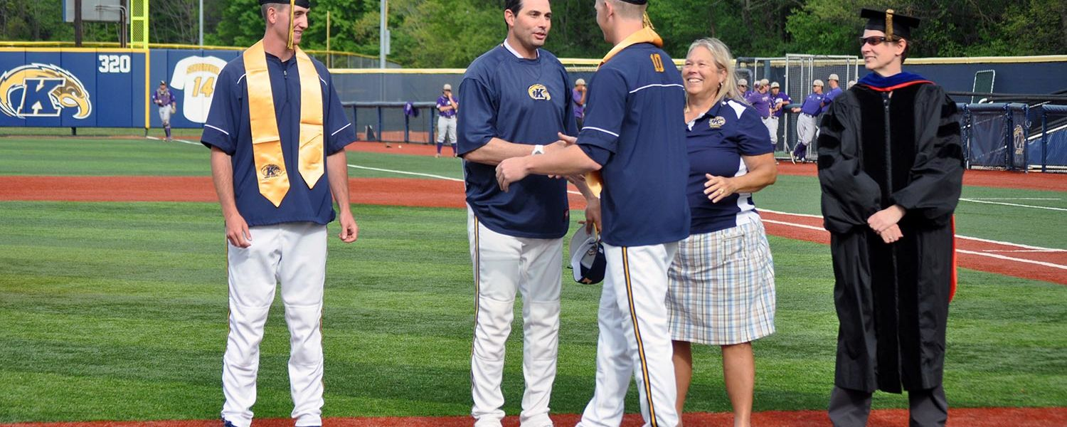 Kent State pitcher Eric Lauer (wearing #10) shakes hands with head coach Jeff Duncan as he and his graduating teammates are honored at the annual baseball graduation ceremony held this past spring.