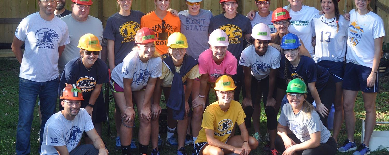 Members of the Kent State volleyball team help out with Habitat for Humanity at a home in Ravenna last month.