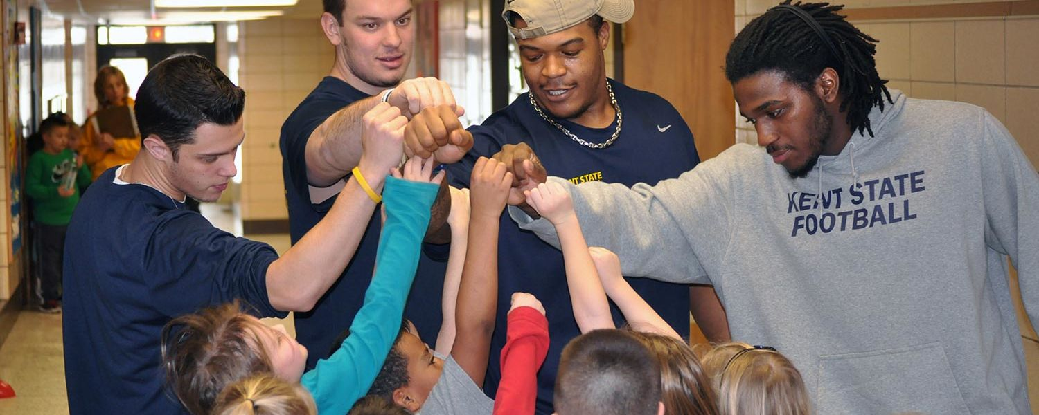 Kent State football players get kids excited during a trip to Willyard Elementary School in Ravenna.