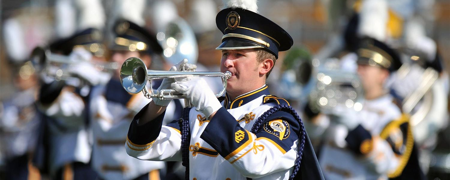 The Marching Golden Flashes perform during halftime of a home football game on the field at Dix Stadium.