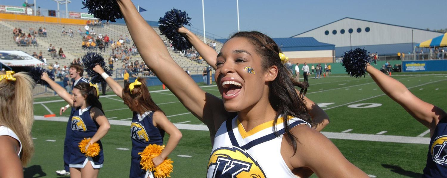 The Kent State cheerleaders fire up the crowd in the main stands of Dix Stadium.