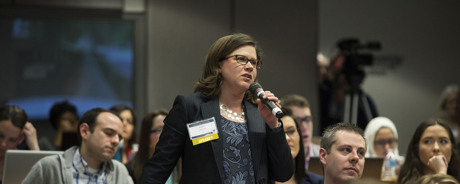 Amy Dolzine of Ernst & Young asks a question at YouToo.