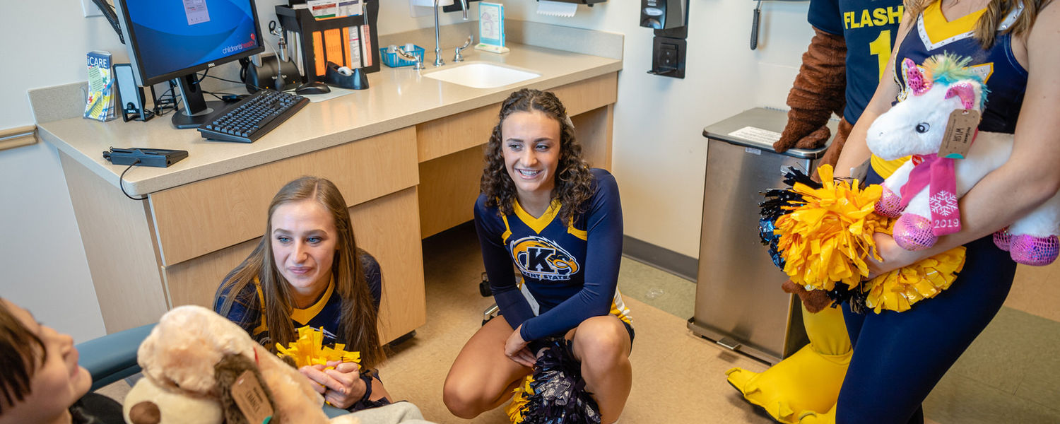 Kent State cheer and dance spend time with children at Children's Medical Center Plano