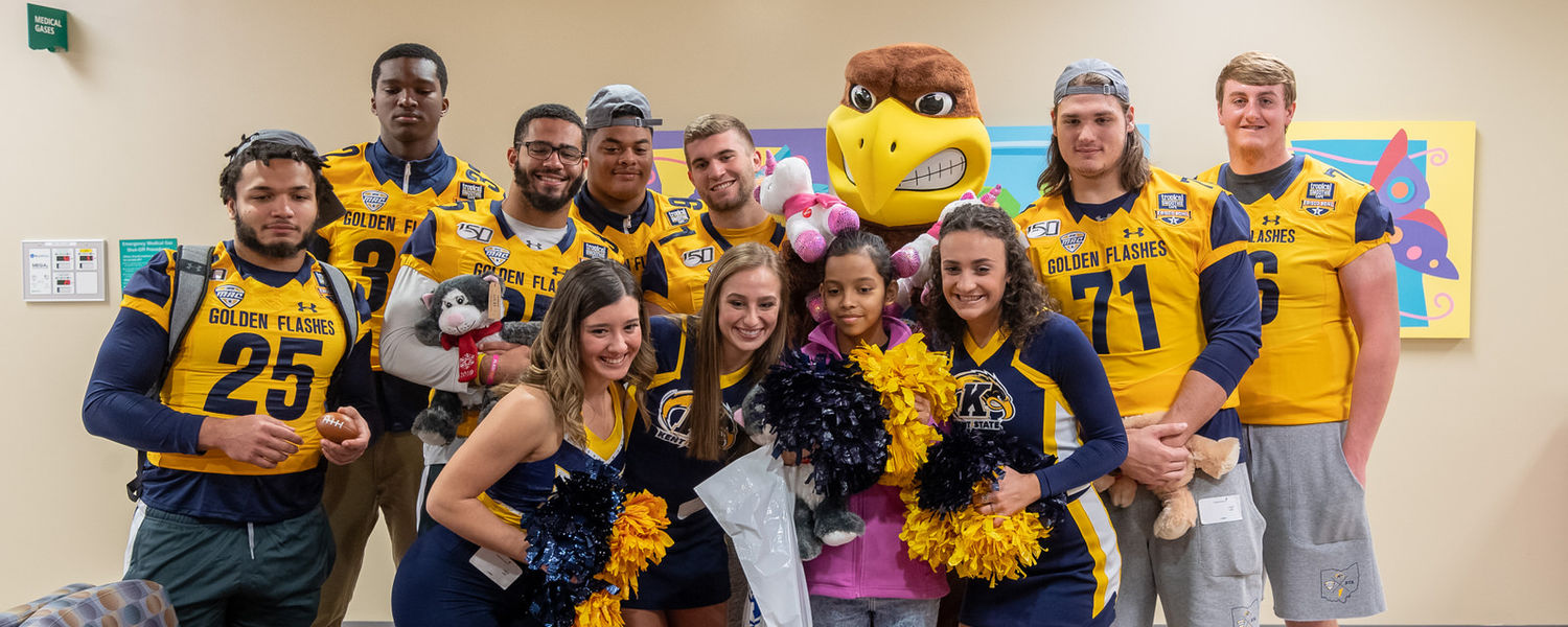 Members of Kent State football, dance, cheer and the marching band visited kids at Children's Medical Center Plano