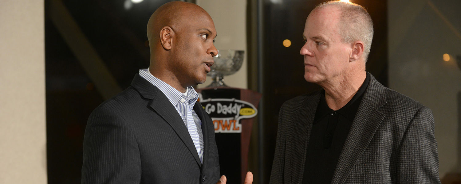 Kent State coach Darrell Hazell and Arkansas State interim coach John Thompson talks in front of the GoDaddy.Com Bowl trophy during a press conference at Ladd-Peebles Stadium in Mobile, Ala.