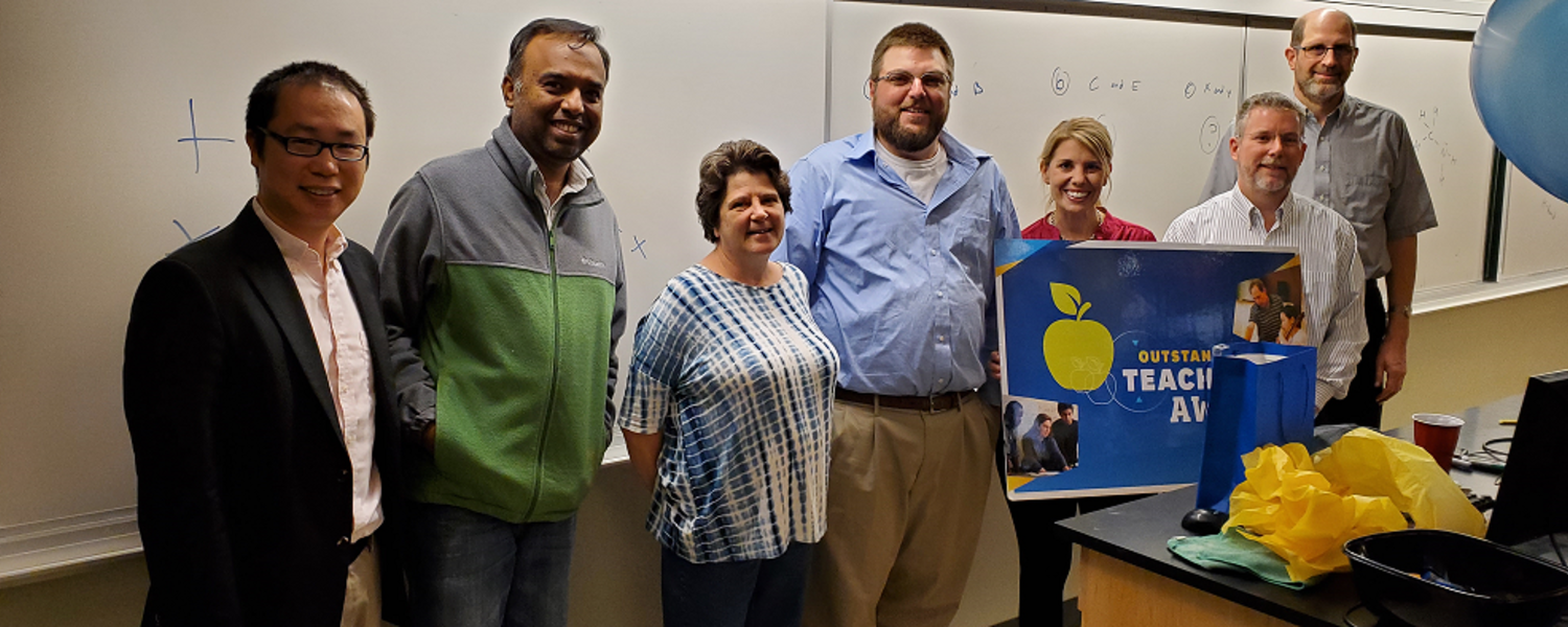 Faculty congratulate Dr. David Bowers, who was chosen to receive the OTA.