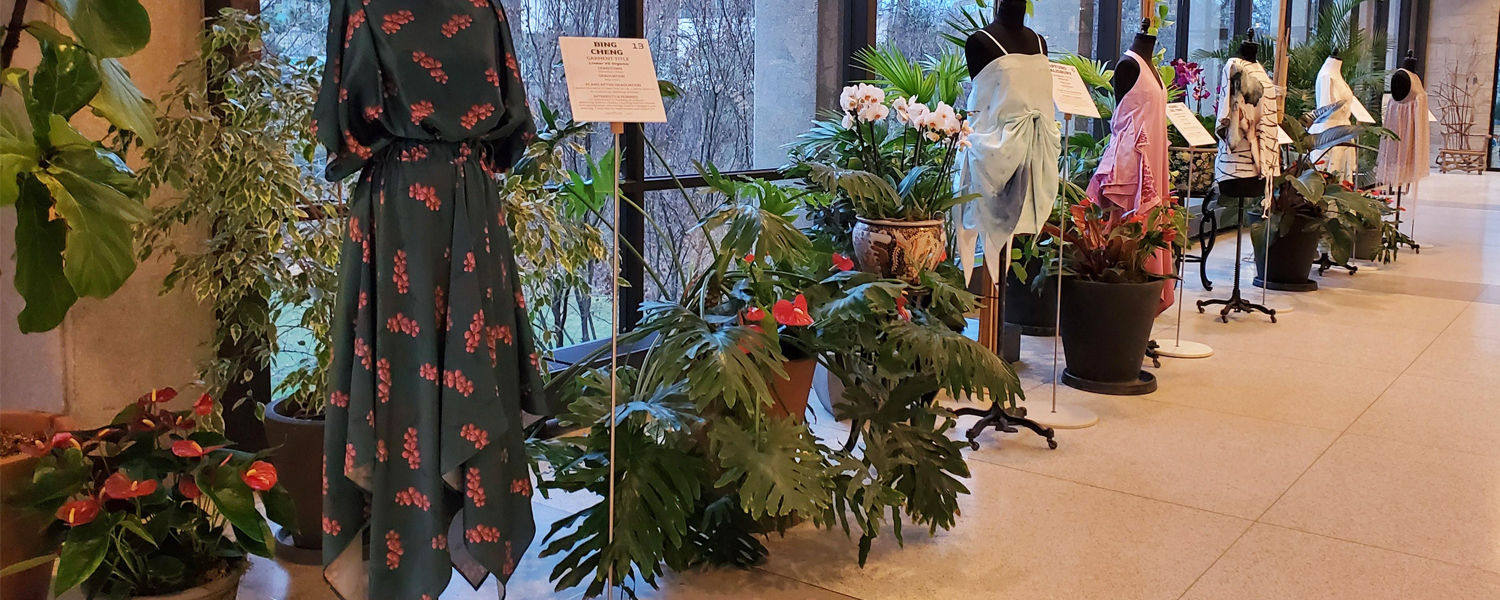 """Garments on display in the """"Fashion Meets the Botanicals"""" 2020 exhibition at the Cleveland Botanical Garden."""