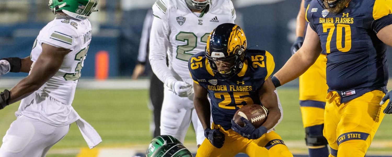 Kent State Wide Receiver Ja'Shaun Poke looks to break free against Eastern Michigan