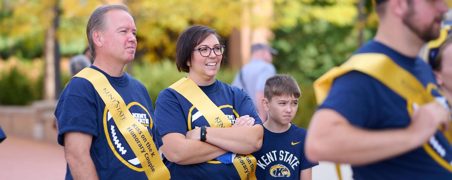 Wal, '95, and Kristina Bainey, '00, participated in Kiss on the K. They met while working at the student center at Kent State University and fell in love over many basketball and football game dates.