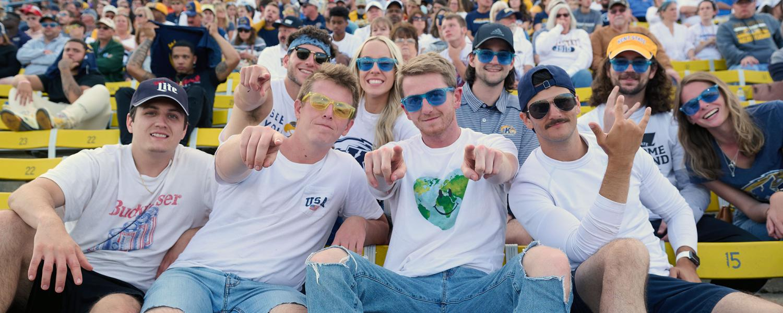Photo of students wearing sunglasses at Homecoming Football game