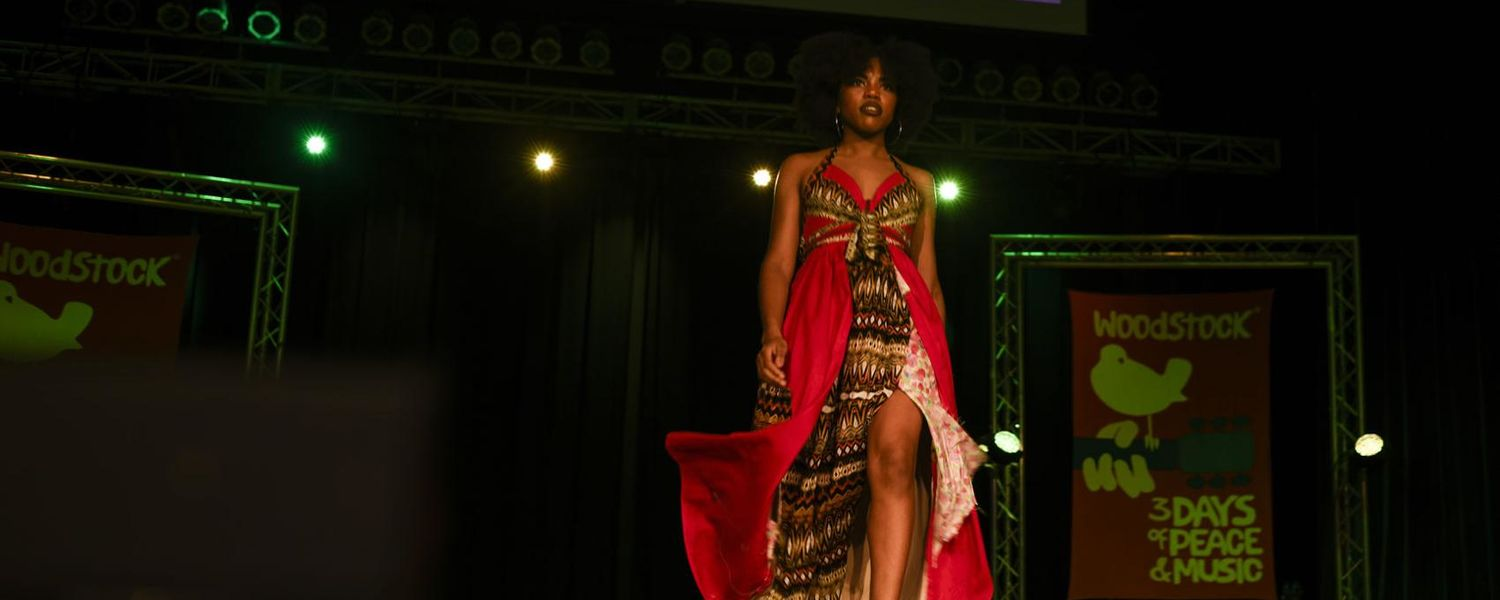 """A model wearing a design from Wuede Tadesse's """"Spark of Beauty"""" collection walks down the runway during Rock The Runway. Photo by Melanie Nesteruk, Kent Wired."""